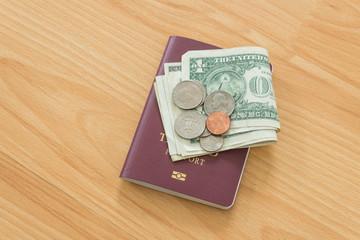 dollar bills and coins thai passport