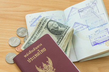 passport stamps dollar bills passport