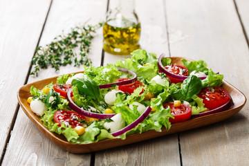 salad with mini mozzarella and tomatoes corn