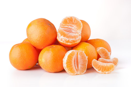 Clementines unpeeled and peeled - isolated