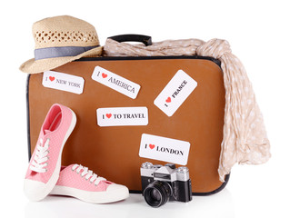 Travel suitcase and stuff for travel isolated on white