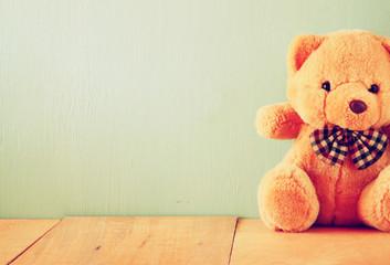 teddy bear on wooden table