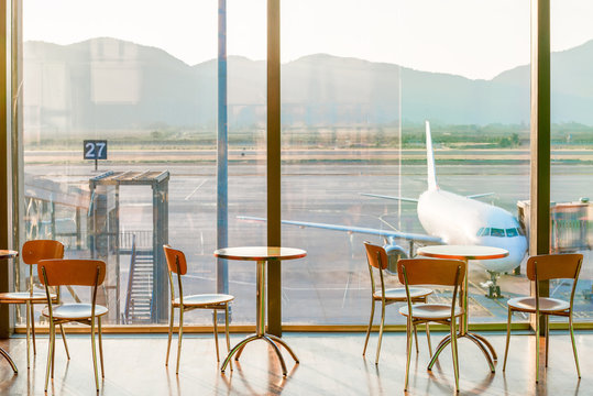 empty cafe tables in the airport and on the plane view