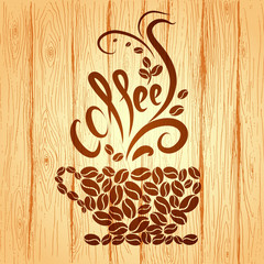 Cup of coffee with floral design elements on a wooden background