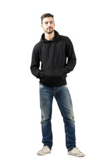 Man in hoodie with hands in pockets