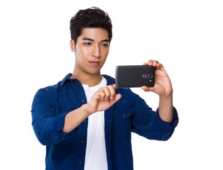 Man use mobile phone to take photo