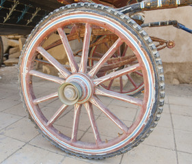 Closeup of old wooden carriage wheel