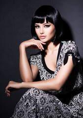 Beautiful woman with short black hair.