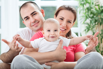 Beautiful smiling happy family enjoy at home