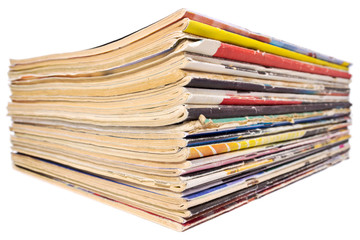 Pile of old magazines isolated on white