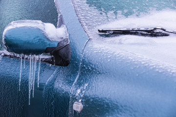 Frozen rearview mirror and wiper of the car