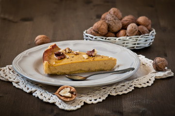 Walnut cake with pumpkin on wooden backgraund