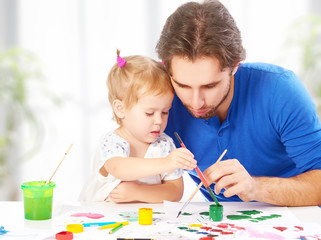 happy family father and child baby daughter together draw paints