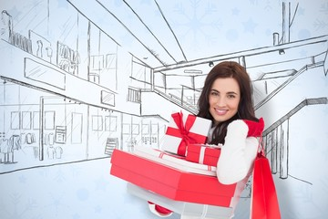 Brunette holding christmas gifts and shopping bags