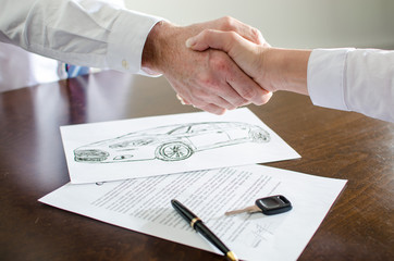 Dealer shaking hands with his customer