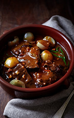 Beef braised in red wine sauce with onions