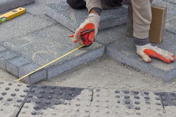 Paver measuring irregular space for laying concrete brick 2