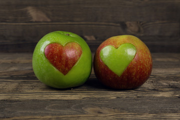 Heart shaped apples on wooden planks