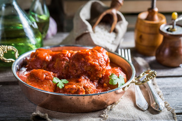 Hot homemade meatballs with tomato sauce