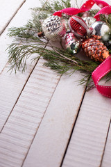 Spruce branches  and vintage decorations on  wooden background.