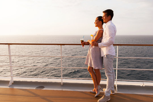 side view of couple having cocktails on cruise ship