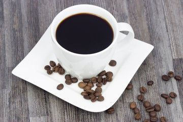 Plate and cup with coffee beans