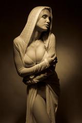Girl in lingerie on dark background.