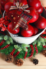 Christmas apples in bucket on wooden table
