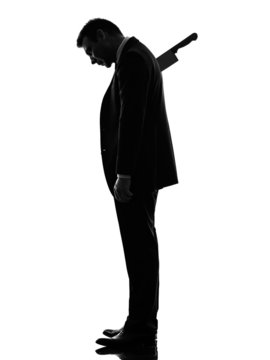 business man Stabbed in the Back silhouette