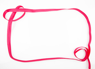 blank frame made of red ribbon isolated on white background