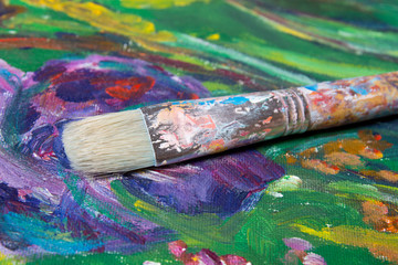 paint brush on colorful canvas background