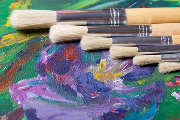 close up of acrylic paint and paint brushes set