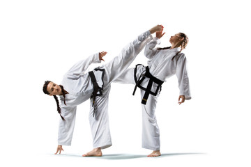 Two isolated professional female karate fighters are fighting