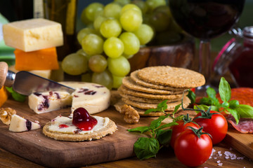 Organic oat crackers with cheese basil and red wine