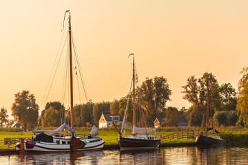River with sailing boats in the Dutch province of Friesland