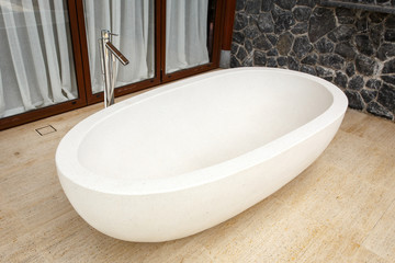 White bathtub made of terrazzo