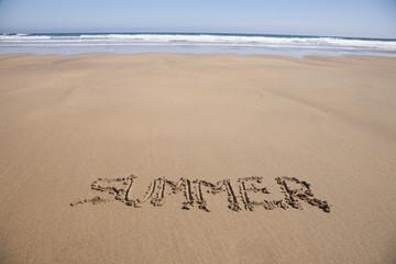 summer text in sand beach