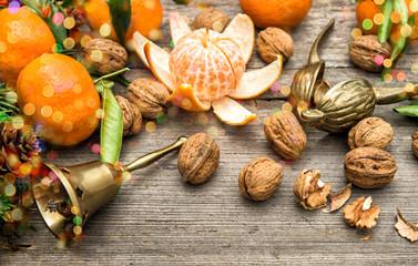 Mandarin fruits, walnuts and christmas tree branches