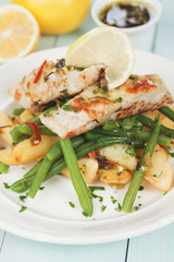 Cod fish steak with fried potato and green bean