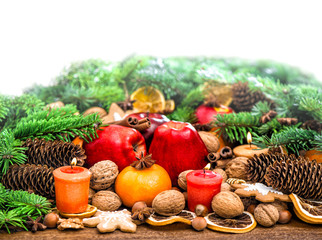 Fruits, cookies nuts and spices with christmas tree branches
