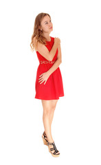 Dreaming woman in red dress.