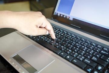 Hand using laptop