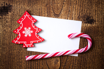 Blank greeting card for Christmas with ornament and candy stick