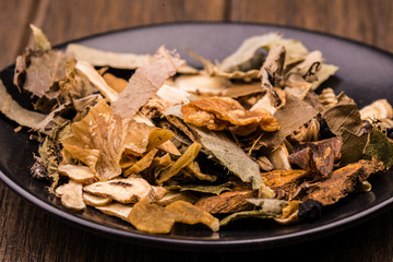 Chinese traditional herbs in the black plate.