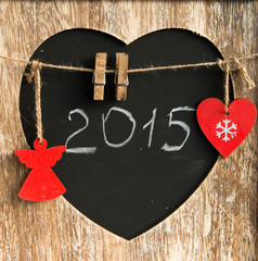 Poster Vintage Poster 2015 written on a blackboard in form of heart with chalk cristma