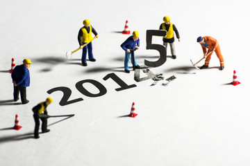 Miniature engineer change represents the new year 2014- 2015