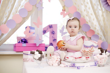 baby girl celebrating first birthday