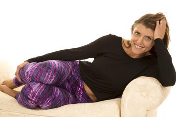 woman black top and purple leggins lay smile