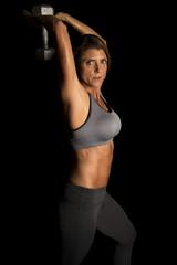 woman gray sports bra on black weight behind head look