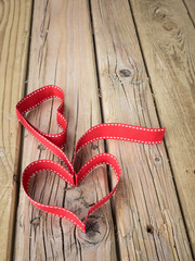 ribbon hearts against grungy wooden background